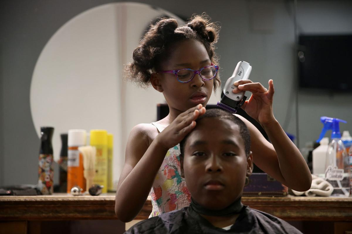 8-year-old titled World's Youngest Barber