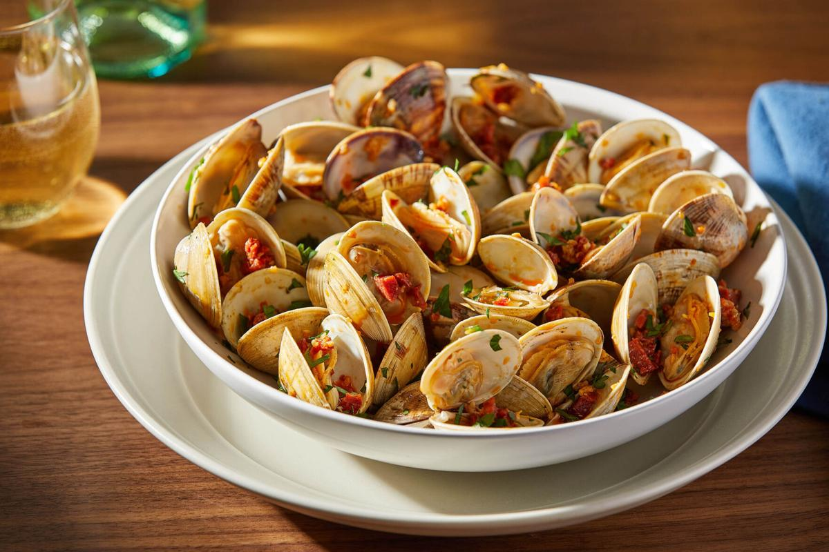 Grilled clams with a chorizo white wine sauce is a flavorful and breezy starter
