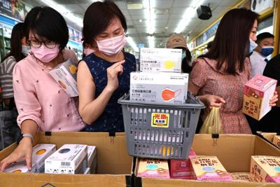 Taiwanese cities tighten restrictions after COVID-19 spike