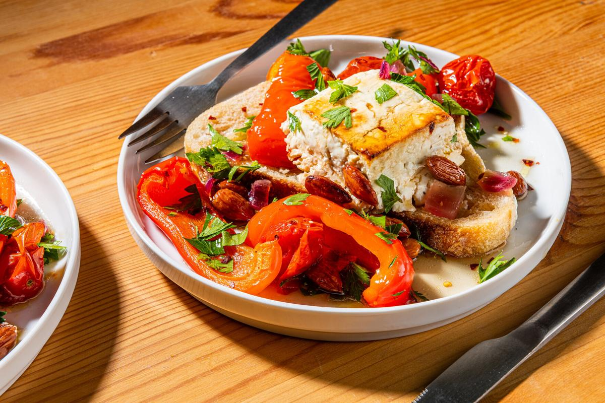 Sheet-pan feta with peppers and tomatoes riffs on romesco sauce for dinner