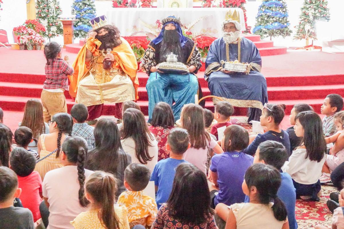 Three Kings celebrate with Barrigada kids