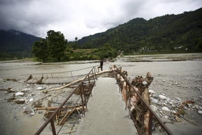 12 dead, at least 21 missing in Nepal landslides