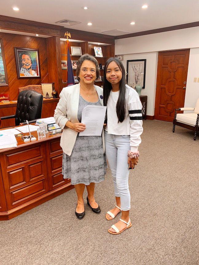 Eighth grader urges officials to cut carbon footprint