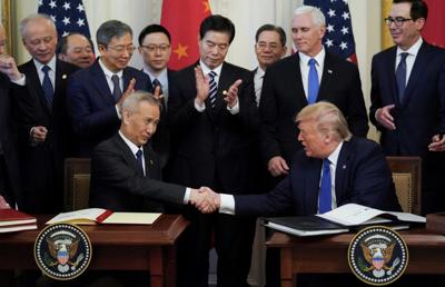 US, China tiptoe around holes in new trade pact