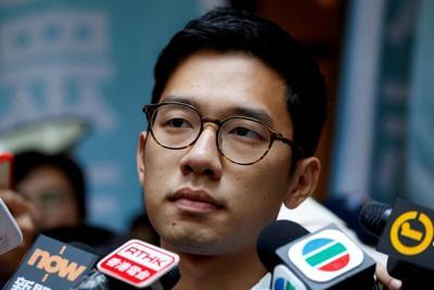 Britain grants political asylum to HK democracy activist Law