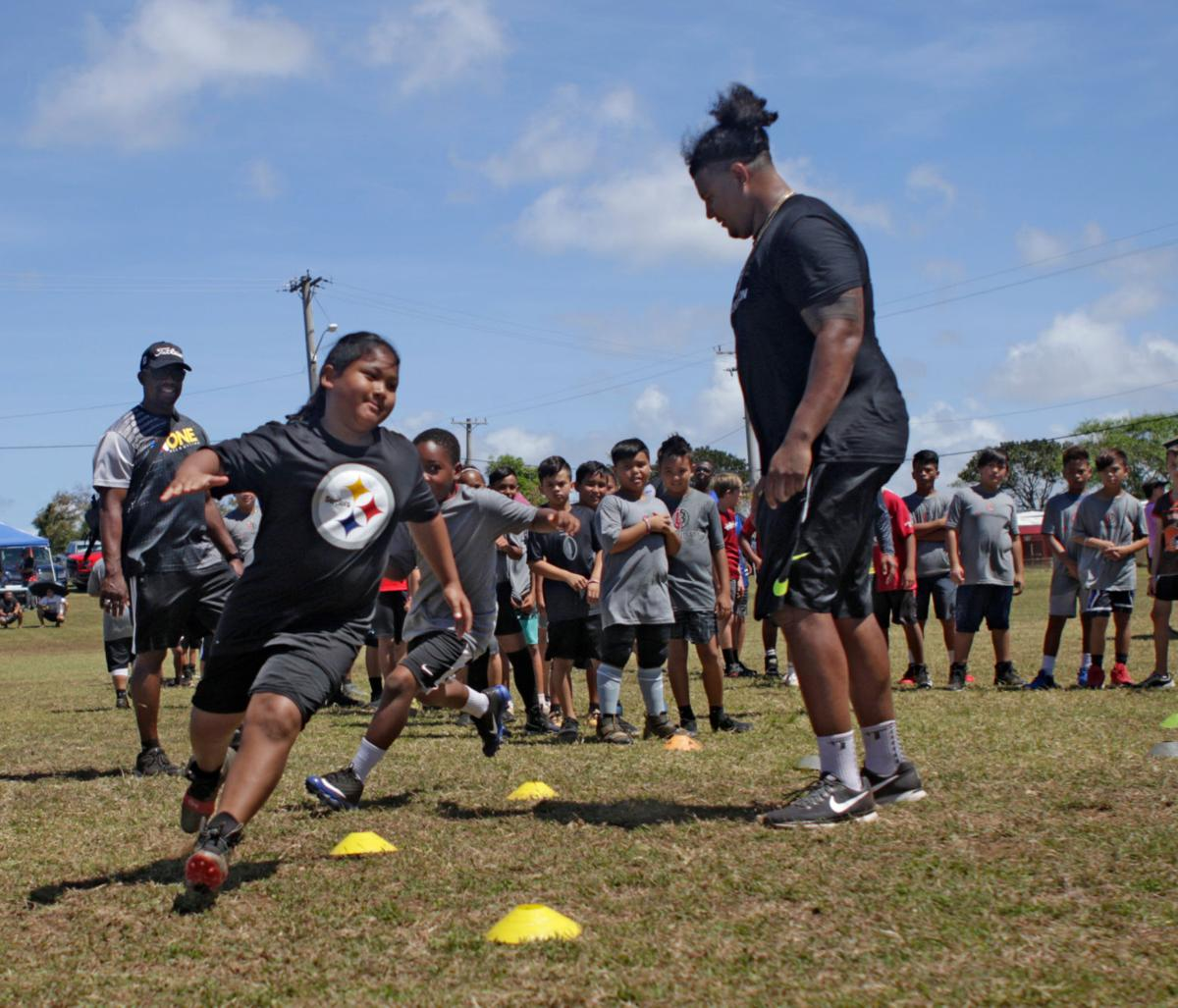 Zach Banner's B3 Foundation, Larry Ogunjobi inspire on Guam
