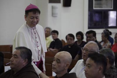 Page 1 - Hon addresses Catholic faithful