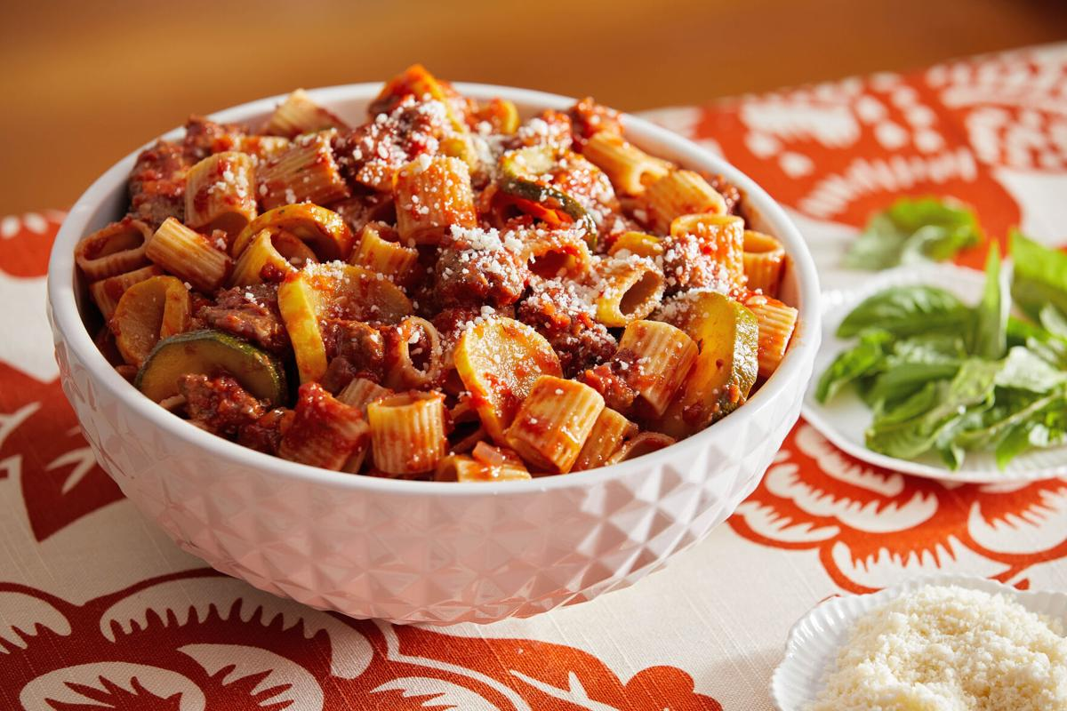 Mild squash meets spicy sausage in this one-skillet pasta dish