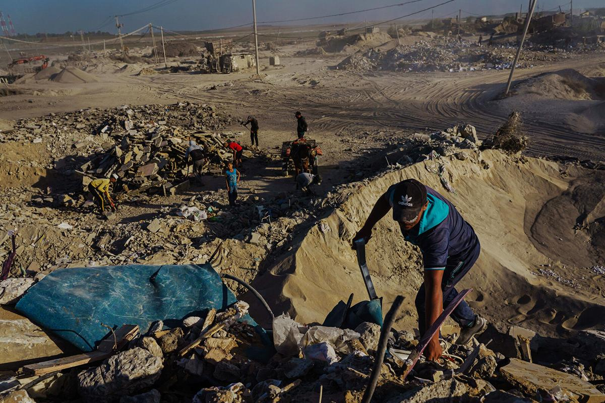 War reduced parts of Gaza to rubble. It's his job to take it away
