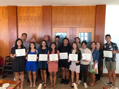 12 students win scholarships