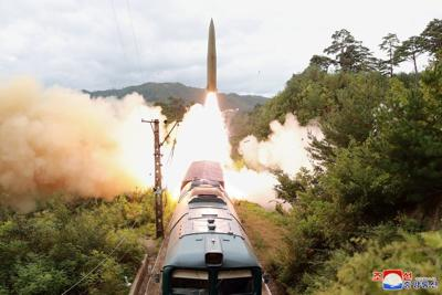 NKorea says it tested new missile system to strike 'threatening forces'