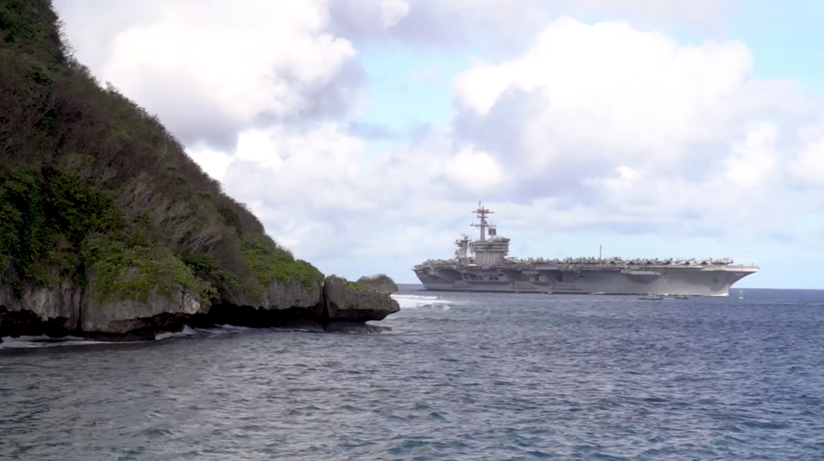 Aircraft carrier arrives on Guam as more sailors aboard test positive for COVID-19
