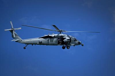Guam-based Navy helicopter squadron airlifts patient from cruise ship