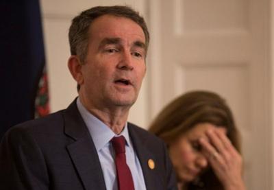 Virginia leaders defy calls to step down