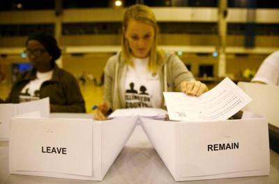 A workers counts ballots after polling stations closed in the Referendum on the European Union in Islington, London