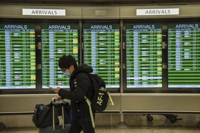 US to end enhanced COVID screening of travelers from overseas