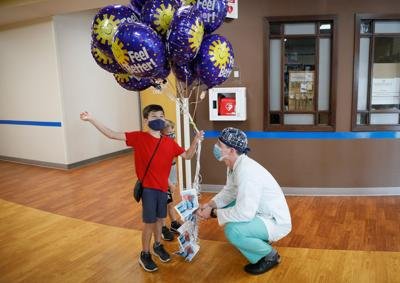 Balloons, cards from 7-year-old brighten hospital patients' day