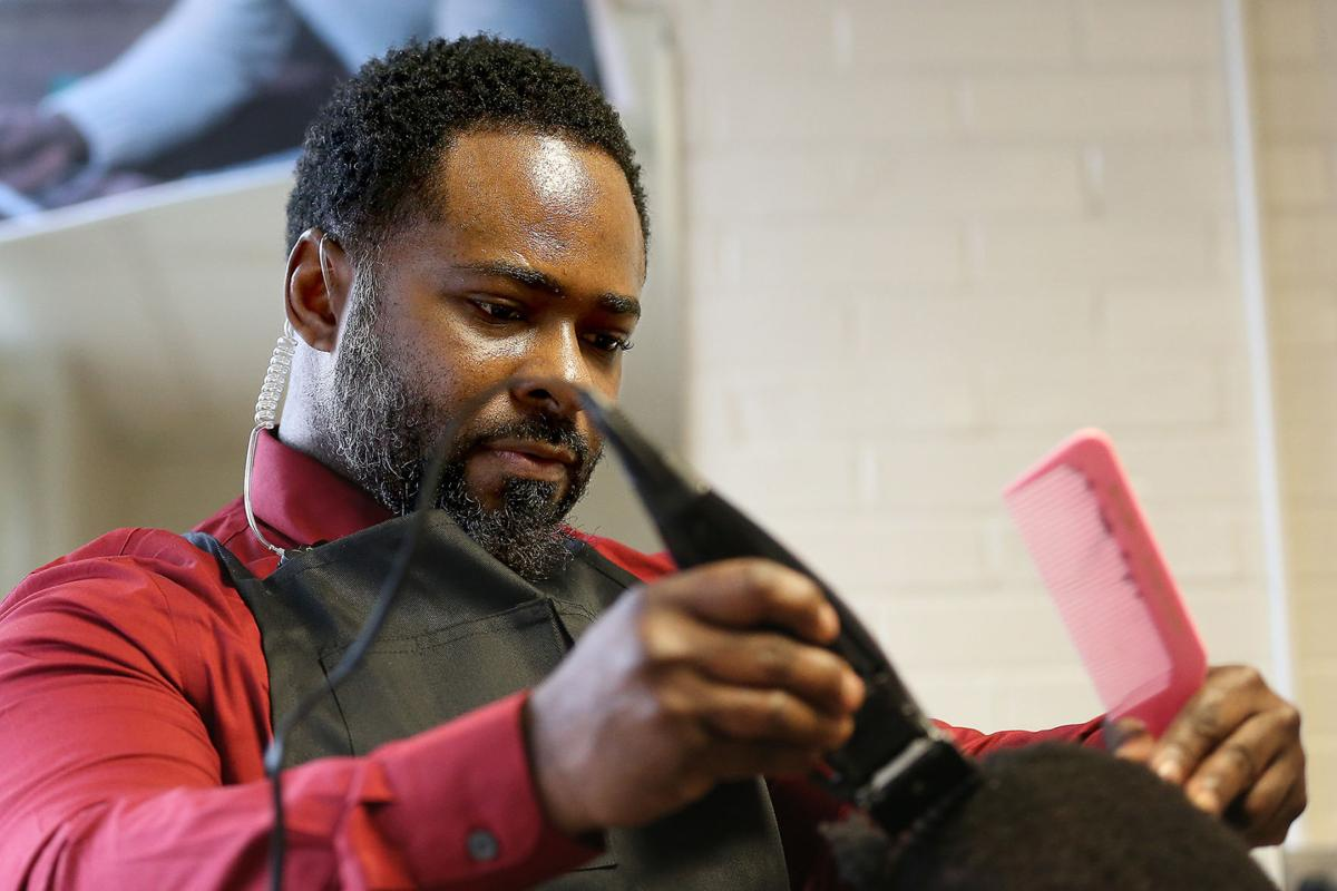 This school principal will do anything for his students, including cutting their hair