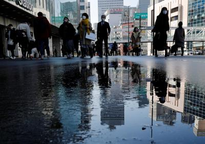 Japan regions push to end state of emergency
