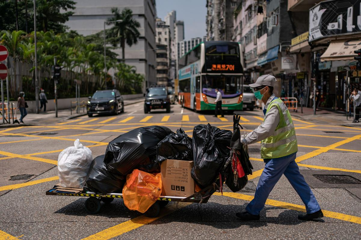 As Hong Kong resets, hygiene army scrapes by