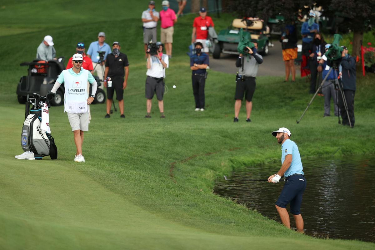 Johnson holds off Streelman to win Travelers title