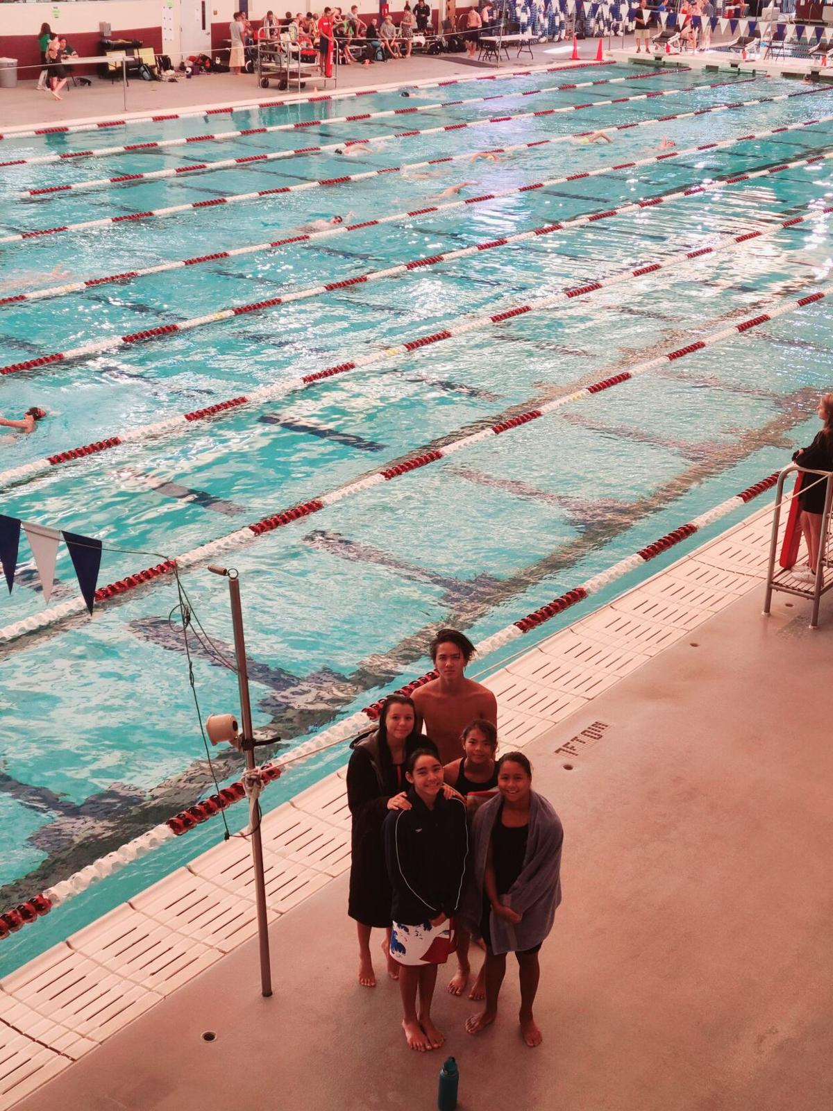Manhoben swimmers advance to finals in long course championships