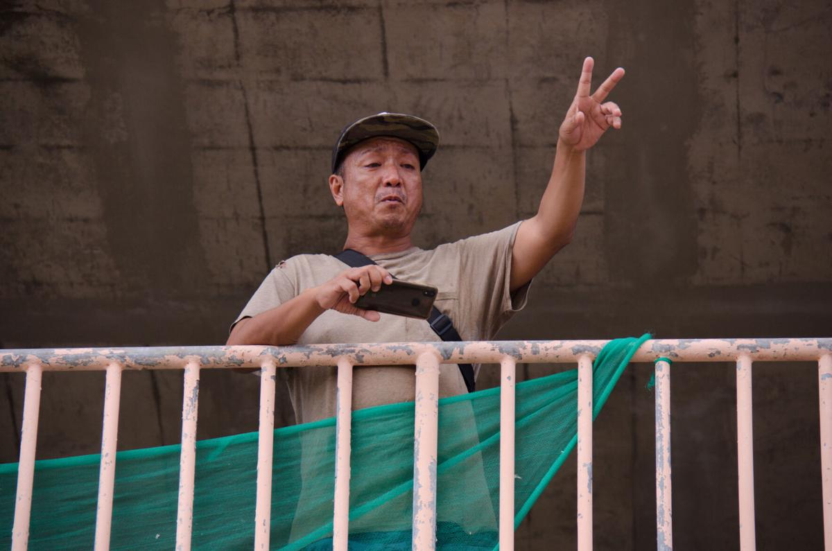 Homeless man seeks help as new garage owner cleans Tumon structure