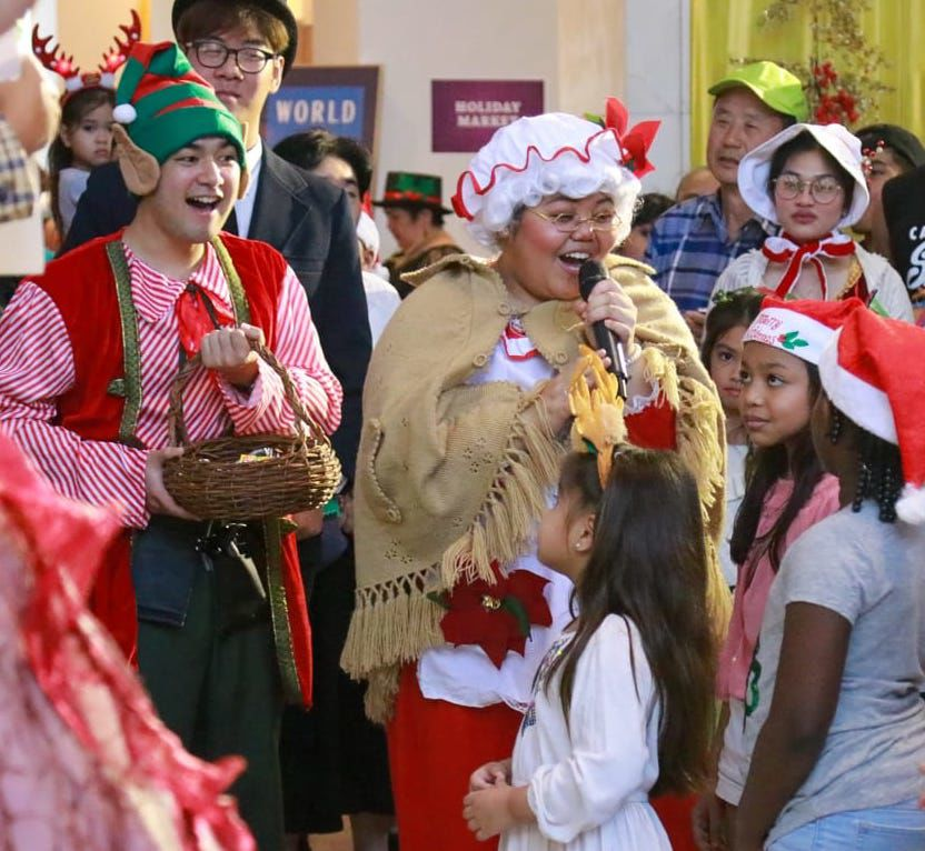Mrs. Claus welcomes kids to gingerbread housewarming
