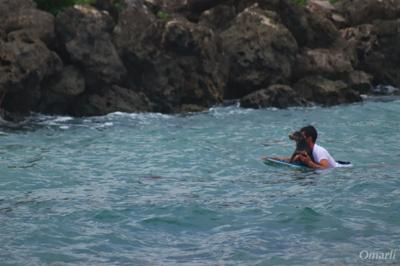 Surfer saves man's best friend