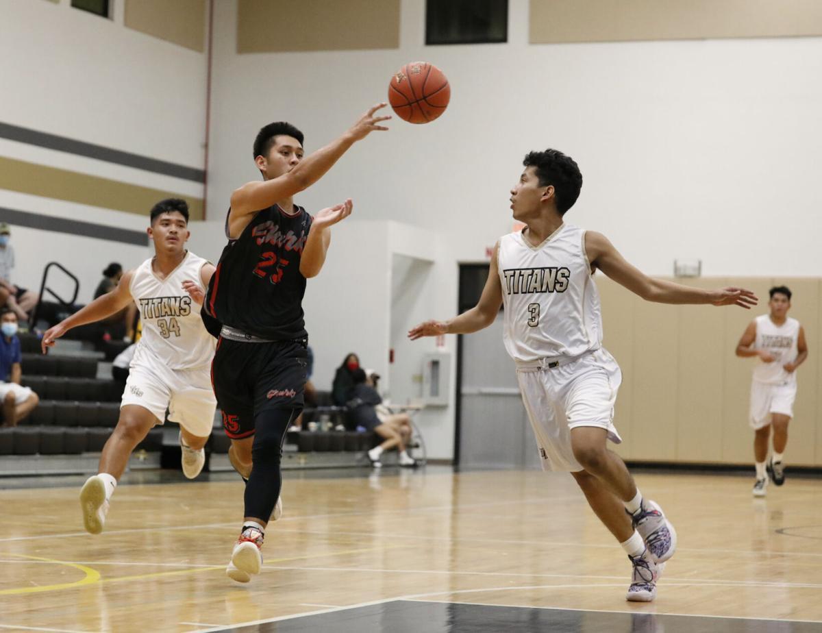 Sharks take advantage of Titans turnovers in boys basketball season opener