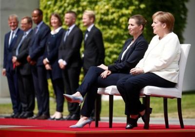 Merkel's shaking episodes fuel health debate