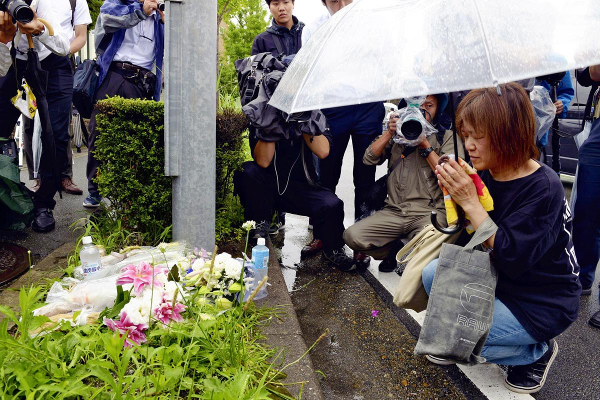 Japan reels as fire probe continues