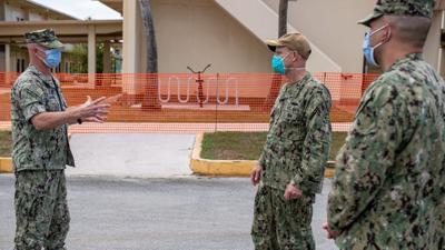 Fleet commander visits COVID-19-stricken carrier