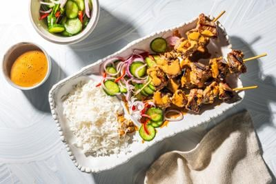 Indonesian sate skewers with peanut sambal are spicy, sour, sweet and salty, all at once