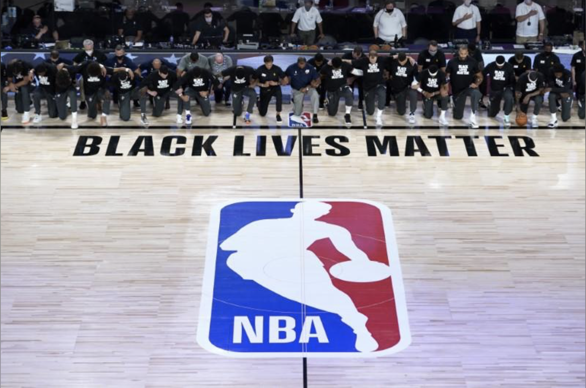 Players kneel in protest as NBA returns to action
