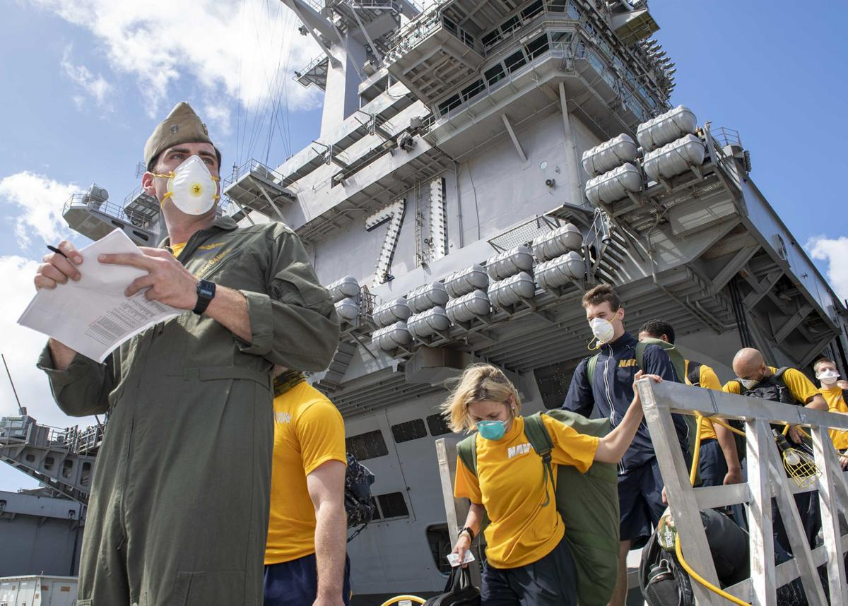 COVID-19-stricken aircraft carrier seeks refuge on Guam