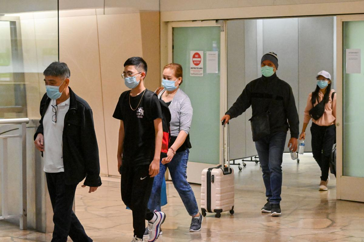 Manila-Guam travel paused due to high virus cases
