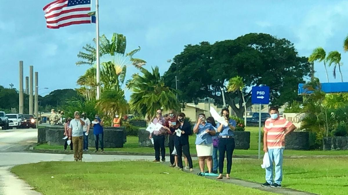 Thousands greet patron saint's drive around the island