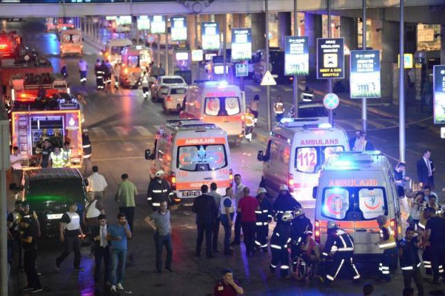 Paramedics help casualties outside Turkey's largest airport, Istanbul Ataturk, Turkey, following a blast