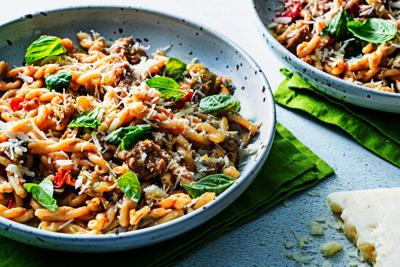 Tomatoes, eggplant and sausage make a quick sauce for this one-pot pasta