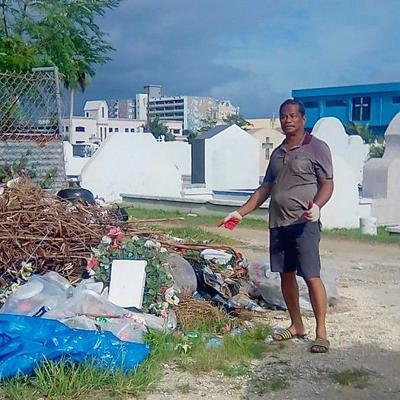 Household trash dumped at cemetery