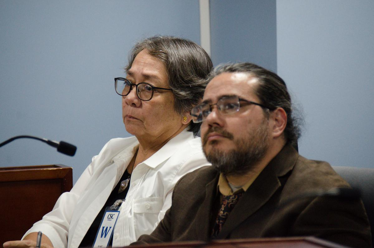 Employees ask governor to reinstate Aguon away from office