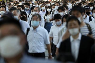 Japan will hospitalize only most serious cases as infections surge