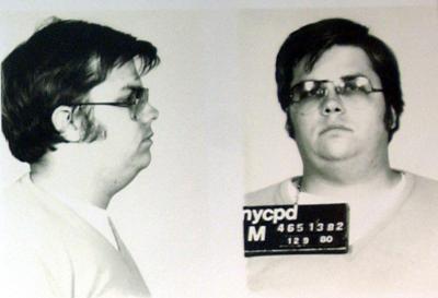 A mug-shot of Mark David Chapman, who shot and killed John Lennon, is displayed on the 25th annivers..