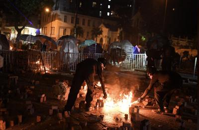 HK protesters unleash petrol bomb stash