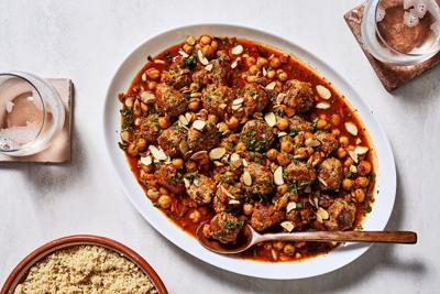 We'd eat these garlicky, spiced meatballs and chickpeas on anything