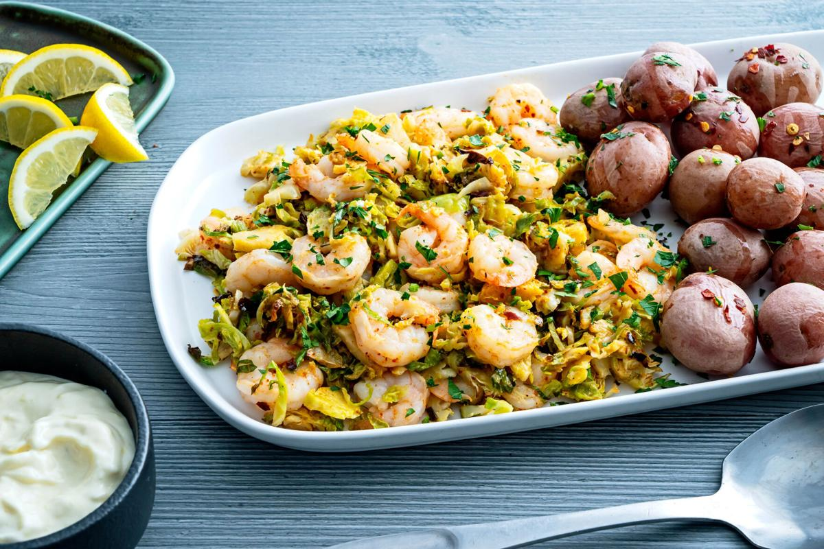 Pair shrimp with shredded Brussels sprouts and a garlicky aioli for a quick and festive supper
