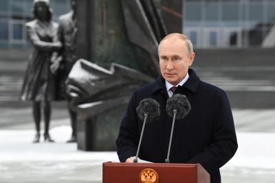 Putin signs law that could keep him in the Kremlin through 2036