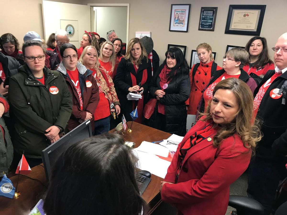 Teachers meet with Del. Elizabeth Guzman, D-31st, on Jan. 28, 2019
