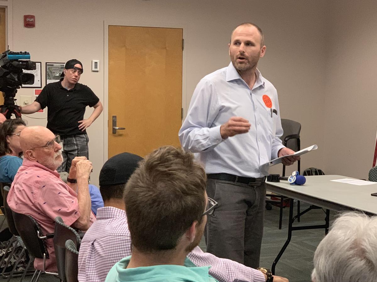 Garth Robbins, a gun rights advocate, speaks during July 1 forum on gun violence
